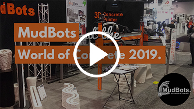mudbots at the world of concrete 2019 youtube thumbnail art with play button