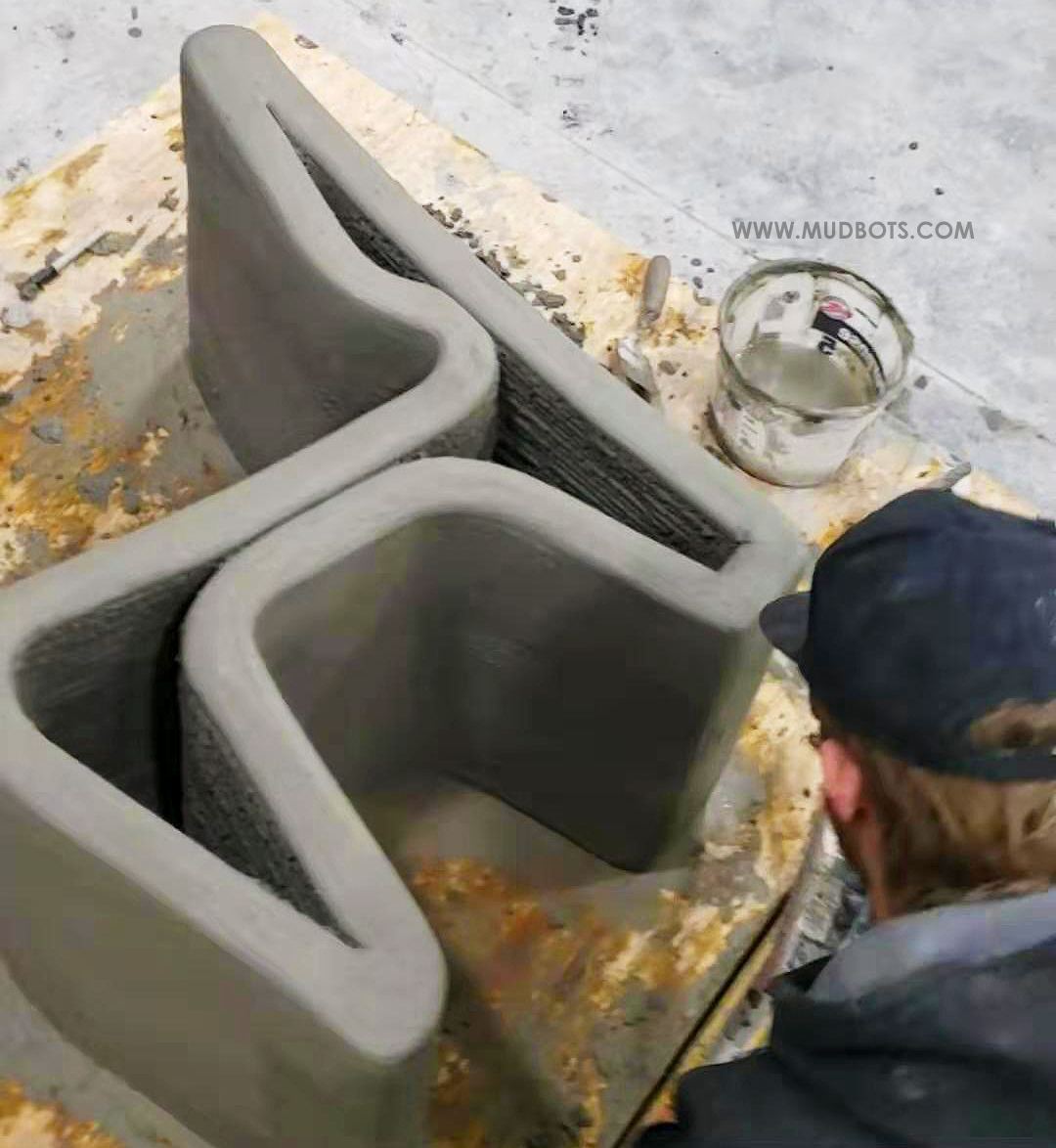 One of the 3D Concrete Printer application is 3D Printing of Outdoor Furniture including, but not limited to, concrete chair.