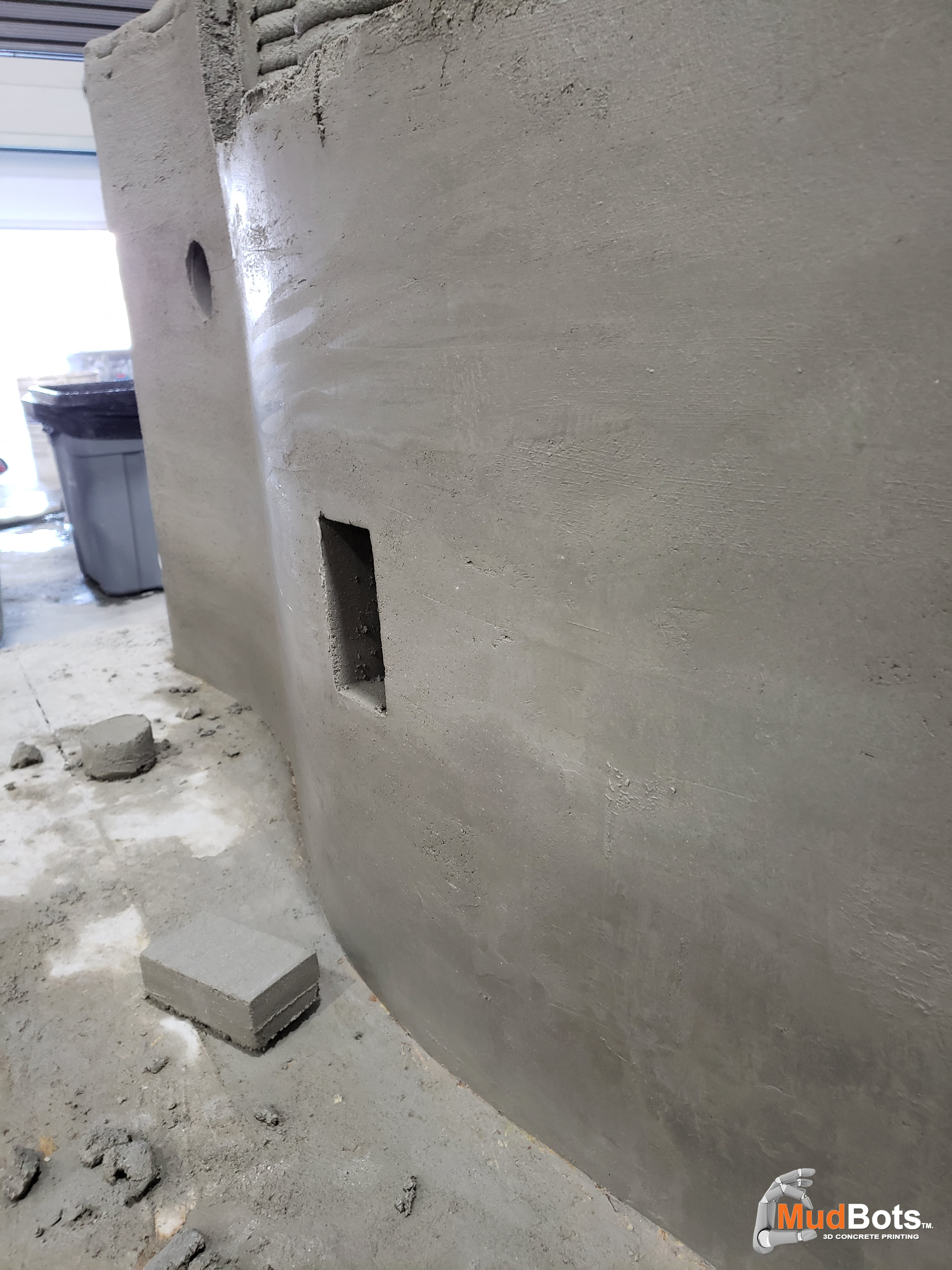Die cutting shapes on finished 3D printed concrete wall structure