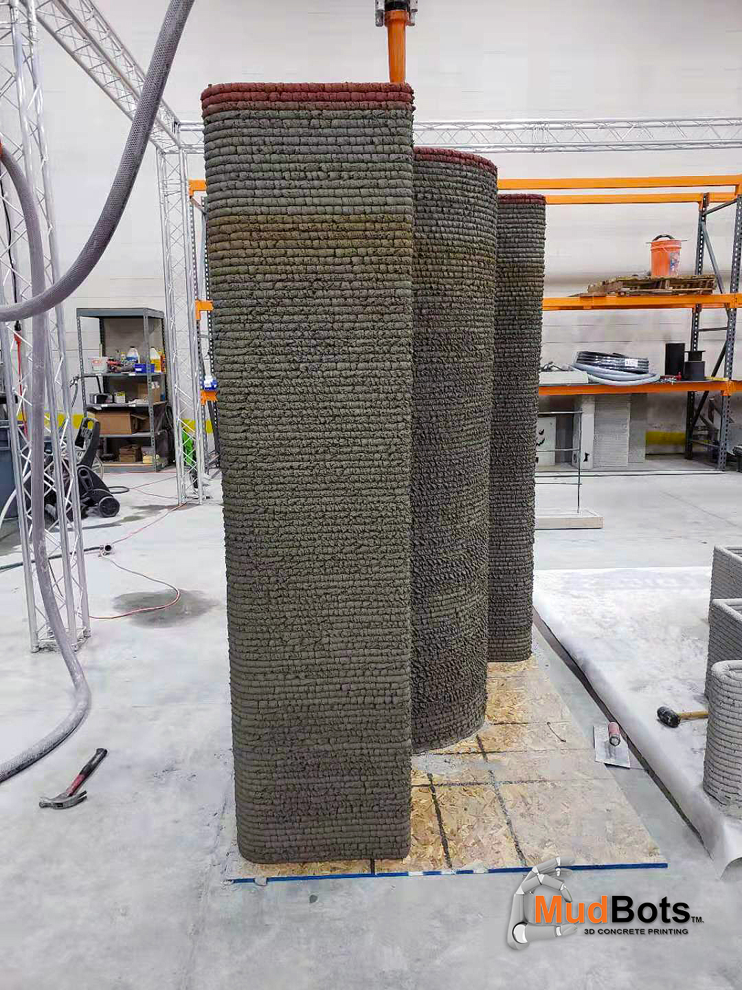 Look at the consistency of each layer. This requires precise data on the characteristics of the mix being used, a mixing/ pumping system that are working in unison at the exact volume rate. This is a wall that was printed from top to bottom in a continual print without stopping. Most walls being shown online are printed in sections on different days because lower layers are not able to support the weight and height of subsequent passes without falling.