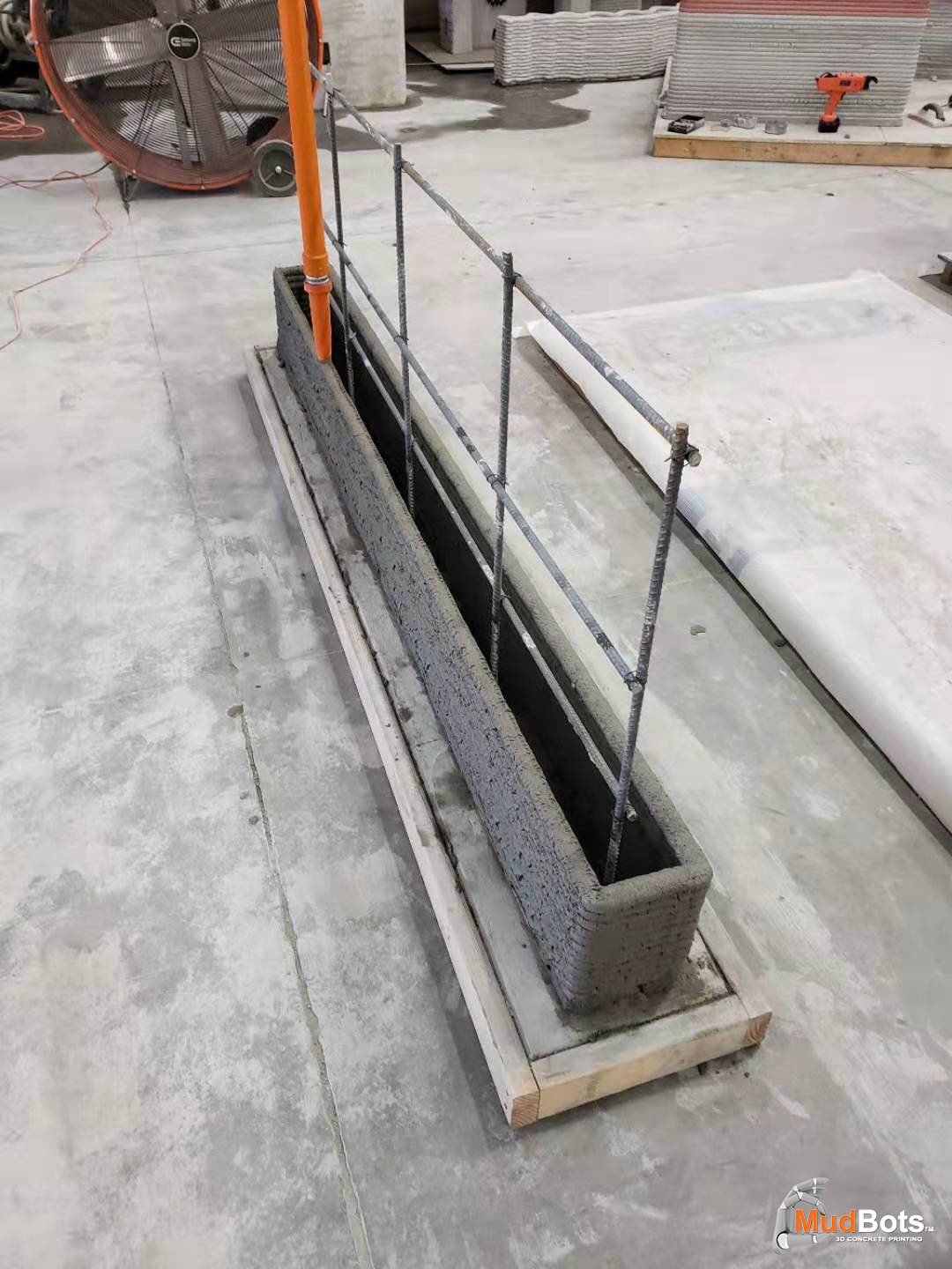 A unique feature with MudBots printers is the ability to print forms for flatwork and footings. Users can print to within an inch of rebar as seen in the image. What most don't realize is that there are mixes that have the structural strength and tensile properties that eliminate the need for rebar all together. Engineers are already adapting to the benefits of concrete printing by specking wall systems that are rebar free which lowers the cost of the wall as well as the electrical and plumbing.